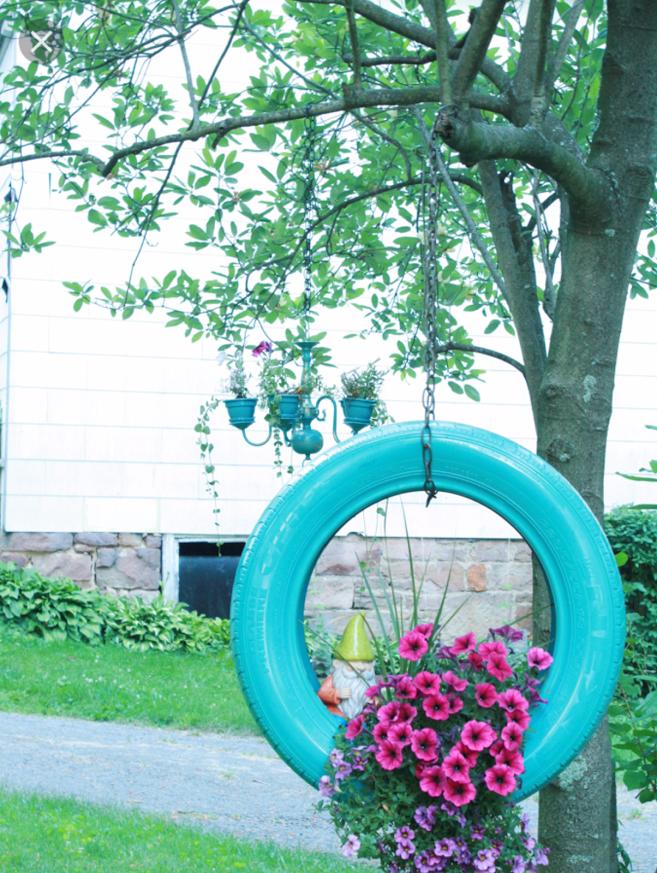 imagenes con ideas recicladas para decorar el jardin con flores