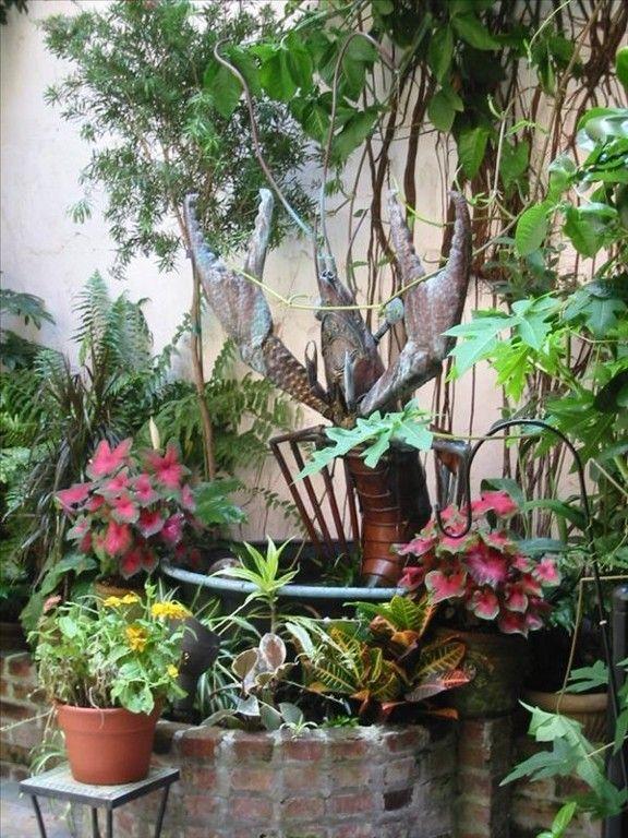New orleans courtyard gardens courtyards patios for French courtyard garden ideas