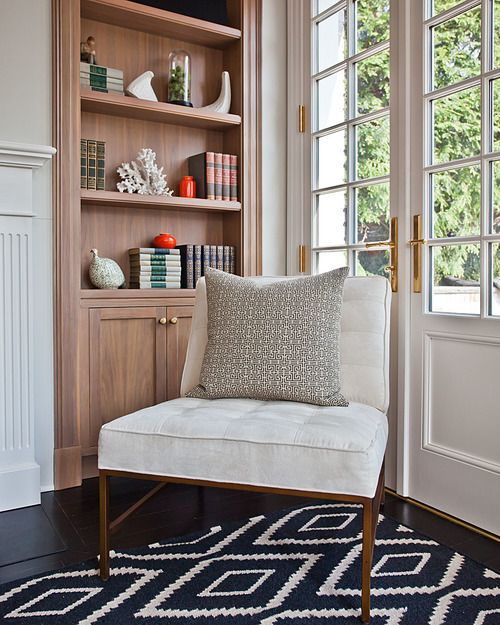 Peaceful Sitting Area In Living Room With Built In Bookcase And Patterned  Rug | Anne Chessin
