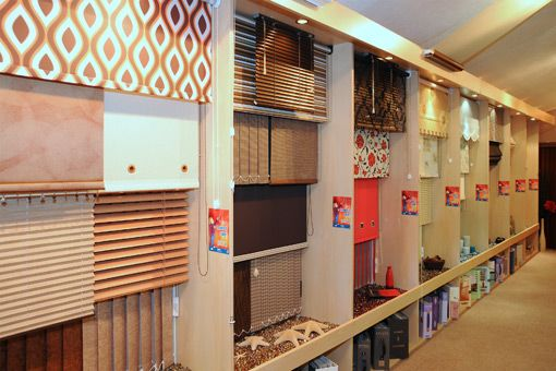 Blinds and drapery showroom blinds curtains bedding for Curtain display ideas