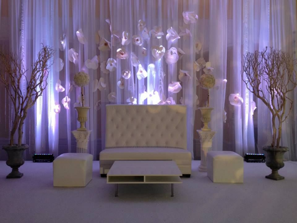 White Leather Tufted Highjack Couch, Pipe And Drape And White Uplighting  For Afghan Wedding Reception