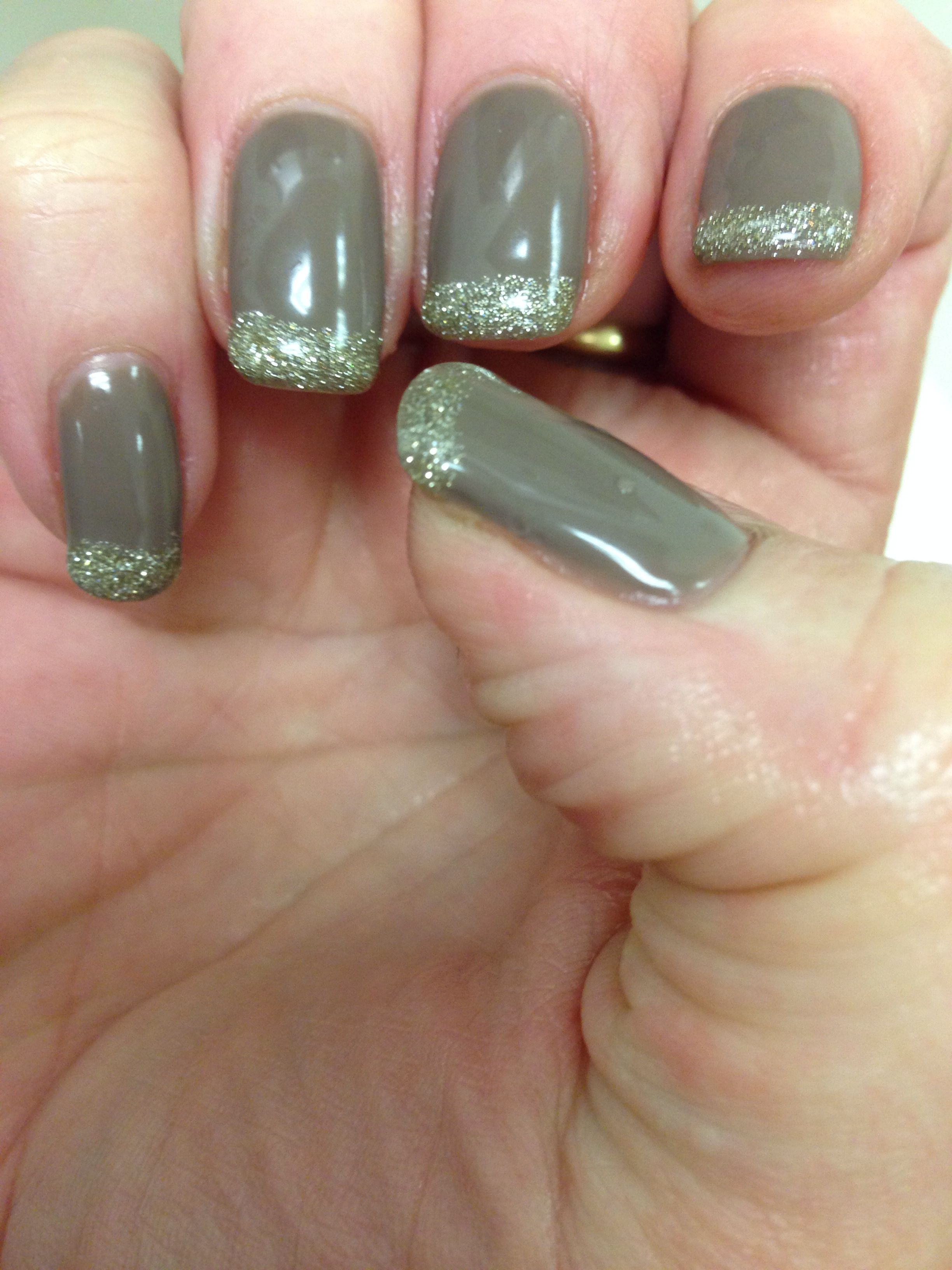Sharon's nails brown with a hint of glitter