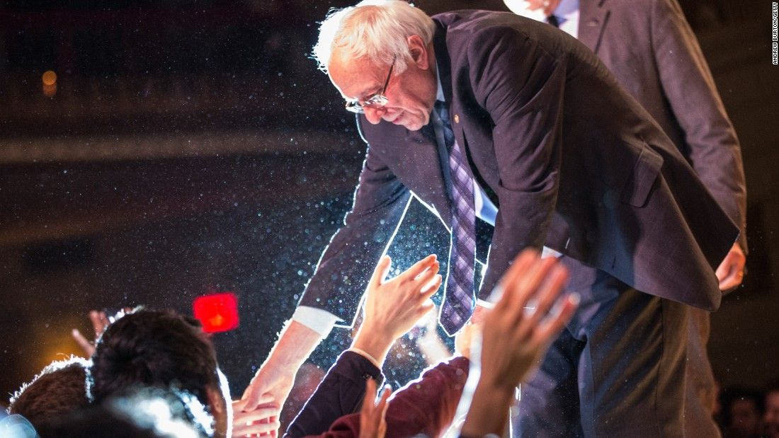 Democratic presidential candidate Sen. Bernie Sanders shakes hands with supporters after outlining his plan to reform the U.S. financial sector on January 5, 2016, in New York City.