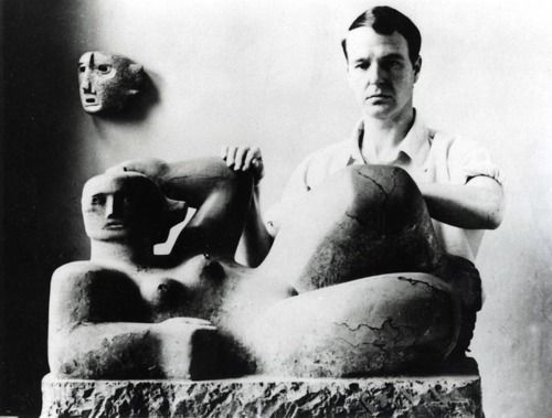 Henry Moore hands on sculpture of reclining nude.  Moore has said that many of his large statues of women were born out of his experiences as a child spent massaging his mother's back.