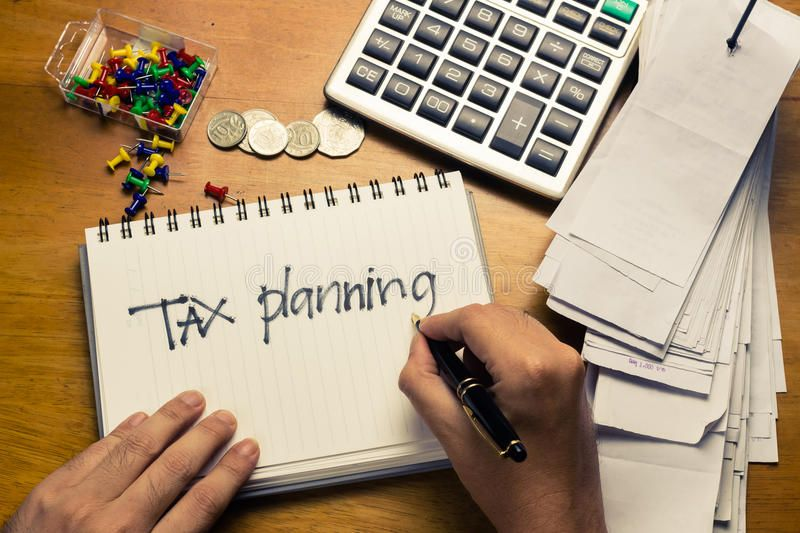 Tax planning. Hand writing Tax Planning word on the