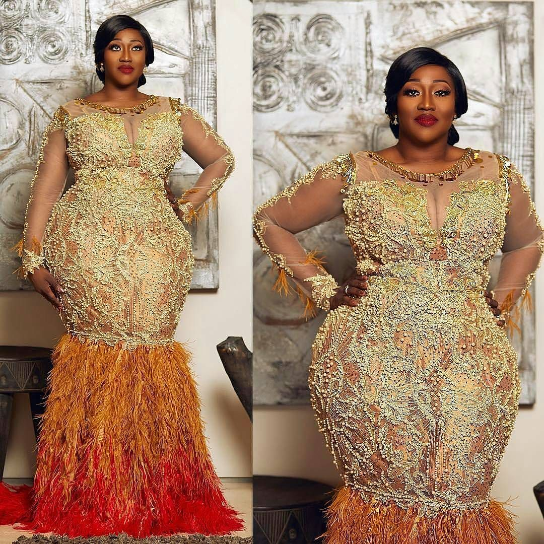 Metallics And Feathers Sharon Celebrated Her 10th Year Wedding Anniversary In This Dress Enti African Lace Dresses African Evening Dresses African Lace Styles