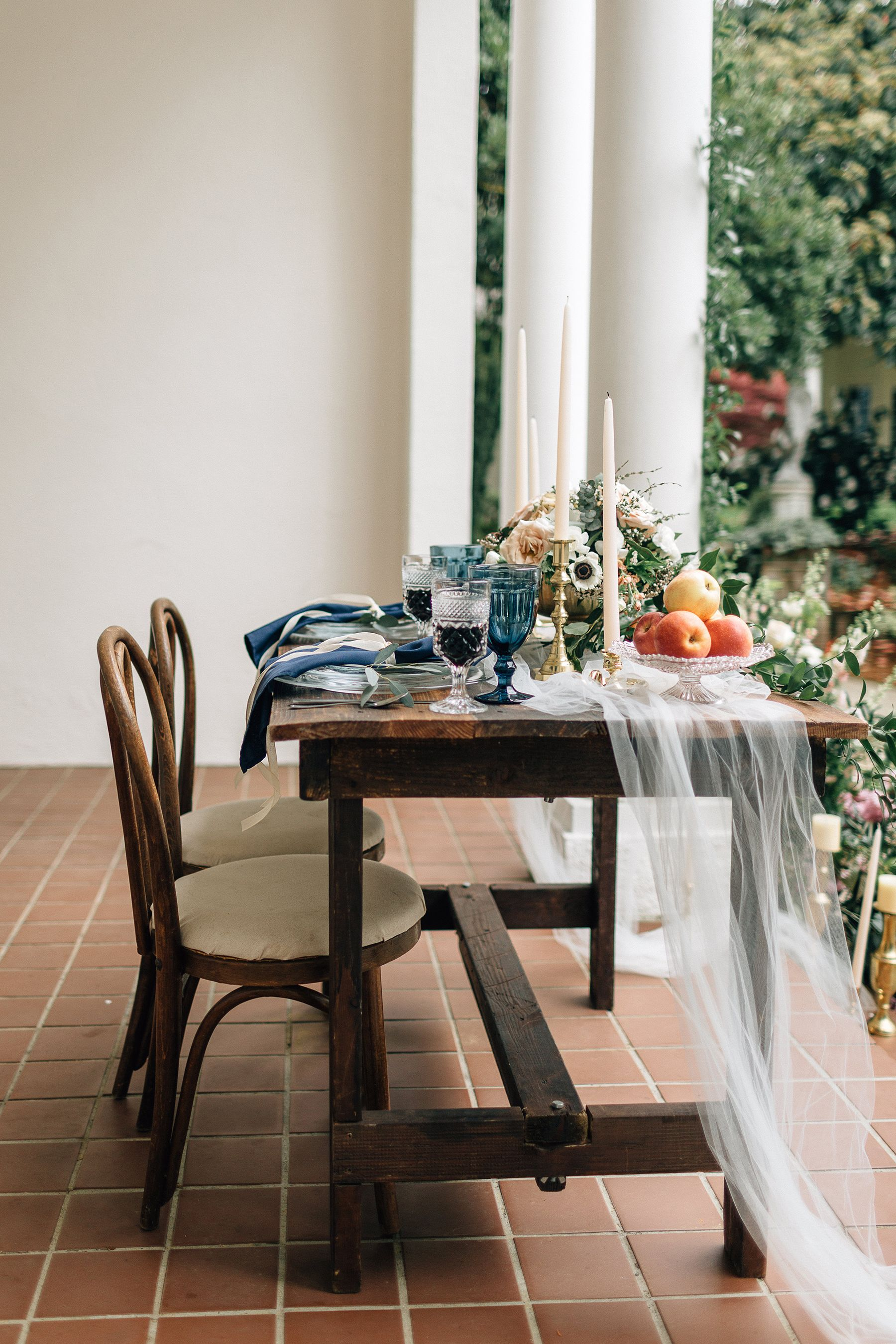 Long wood wedding tablescape with low wedding centerpieces, tulle wedding runner and candles | Romantic Garden Wedding Inspiration in Portland - Amanda Meg Photography #table #tablesetting #tablescape #tabledecor #centerpieceideas #weddingdecor #weddingdecorations
