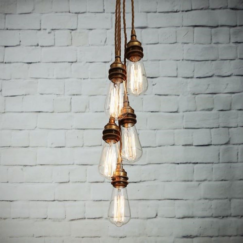 Industrial cluster of pendant lights with seperate ceiling hooks