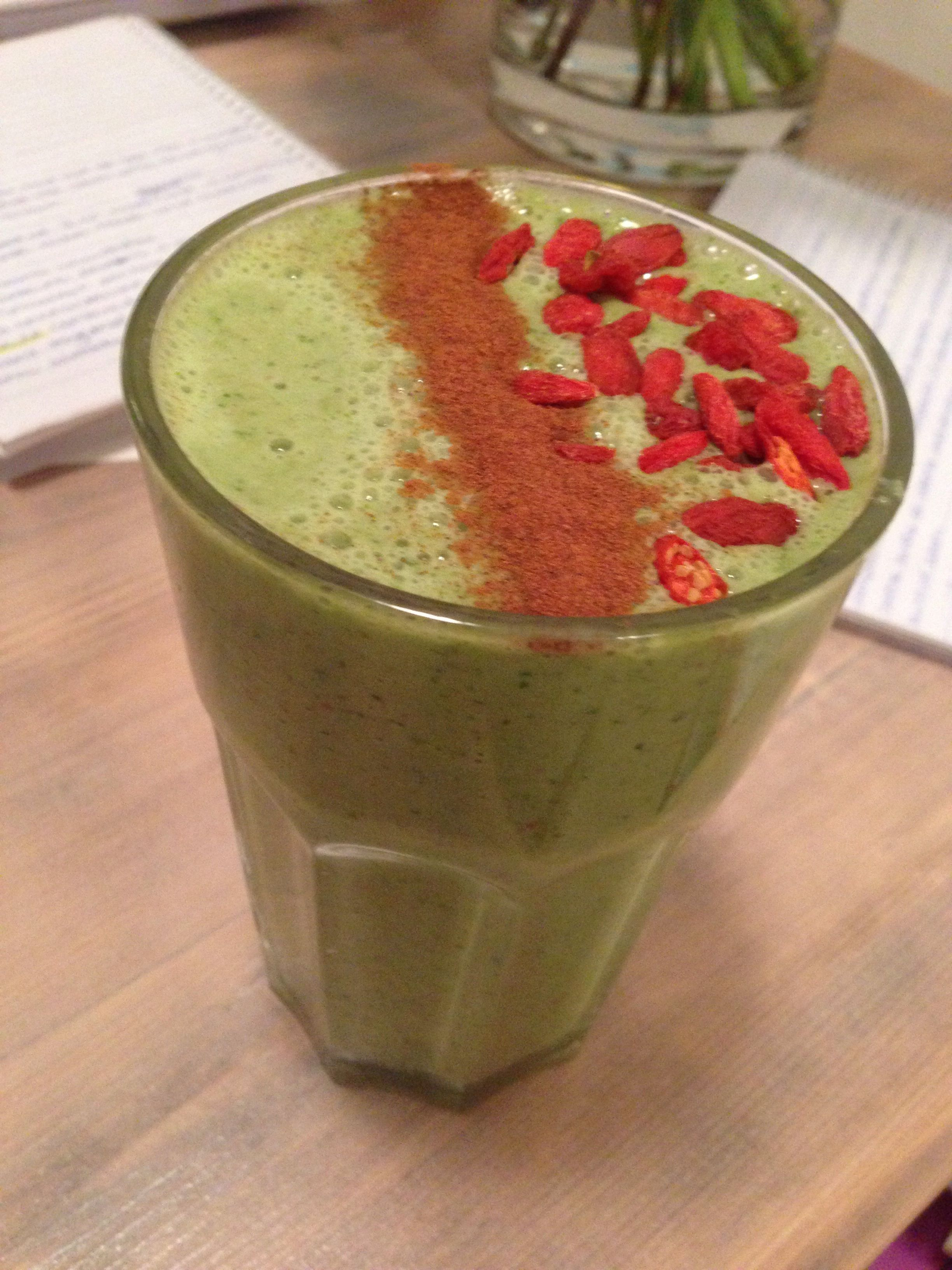 Kale apple strawberry and natural yogurt smoothie  topped with cinnamon and goji berries  delish!