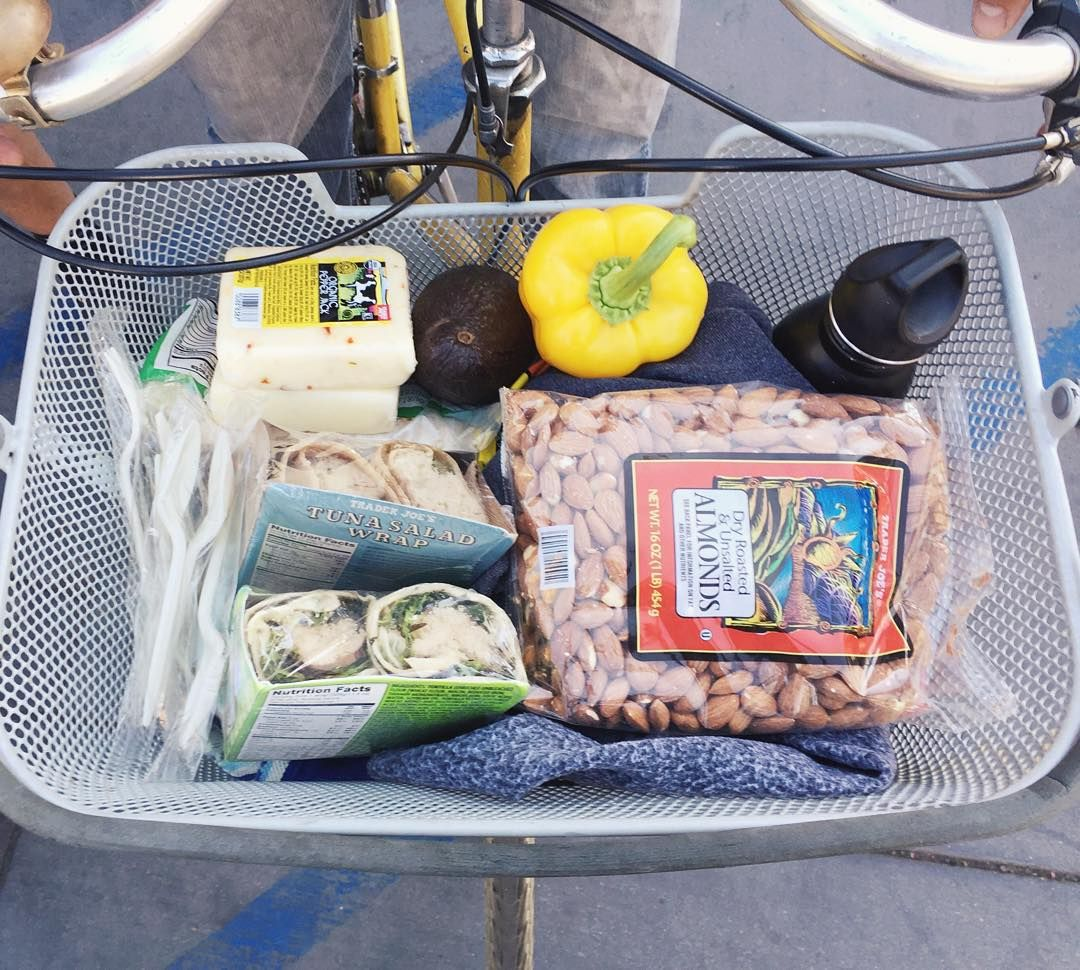 """Today we went on a bike picnic! We rode to Trader Joe's, bought some yummy food, and picnicked at Silver Lake Meadow. Here's Don's bike basket filled with…"""
