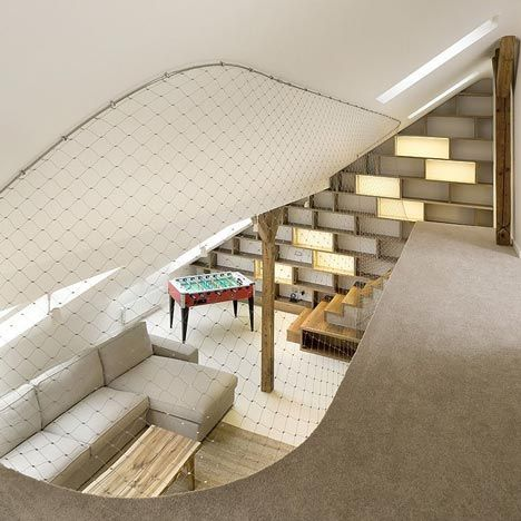 A Stainless Steel Net Takes The Place Of A Banister Around The Staircase  And First Floor