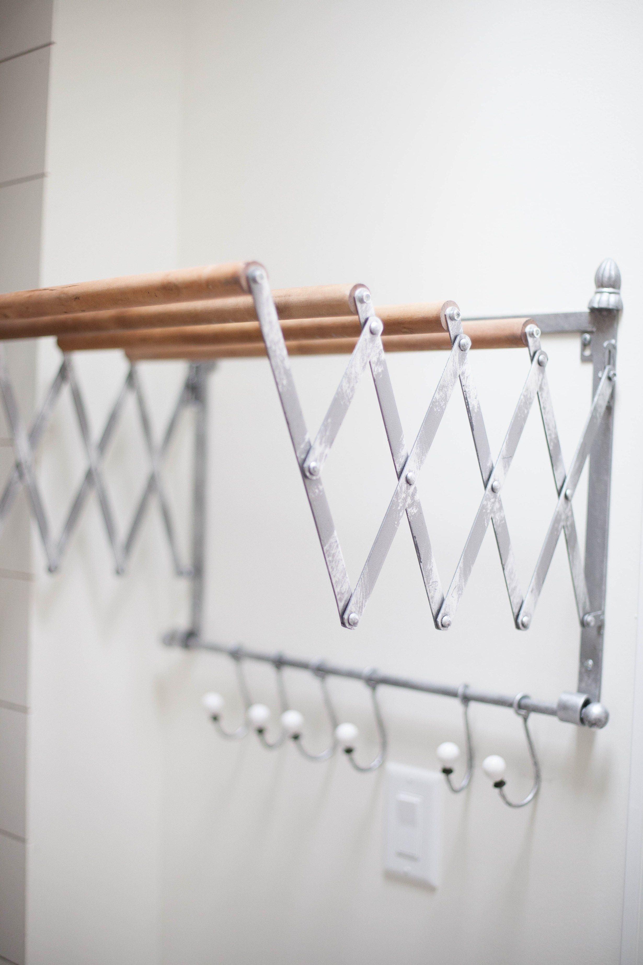 This Accordion Wall Drying Rack Is Fun And Functional For Your Farmhouse Laundry Room