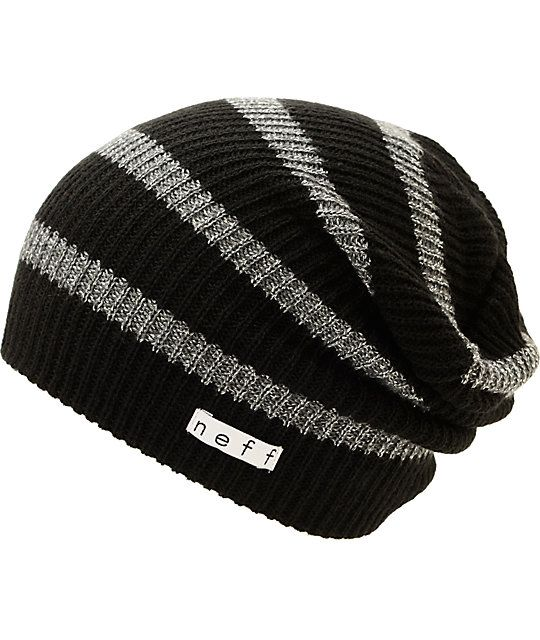 dc93c5973c9 Keep your look fresh from the summits to the streets thanks to this slouchy  beanie made with a black and grey stripe knit pattern with shiny lurex  threading ...