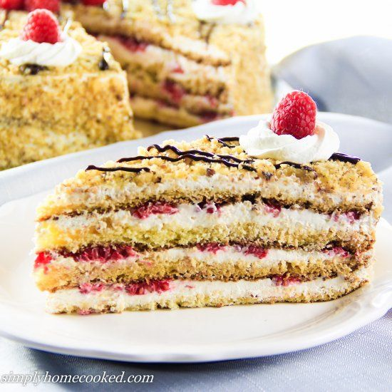 Honey cake layered with raspberries and cream.