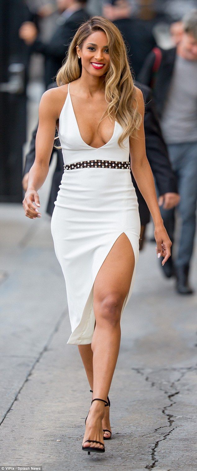 ddacc599 Shapely: The singer and model, 30, showed off her shapely legs in the  outfit that had a skirt slit to the thigh and wore black sandal heels