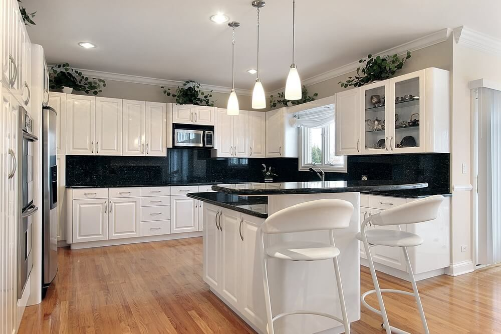 This Contemporary Kitchen Boasts A High Contrast Look, Courtesy Of White  Cabinetry And Jet Black