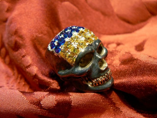 Ukraine skull ring Available in gold with all the colors, yellow white pink, red,, and silver or burnished silver. Stones: Diamonds or colored blue and yellow sapphires, colored or Zircons Dogale Jewellery Venezia Italia
