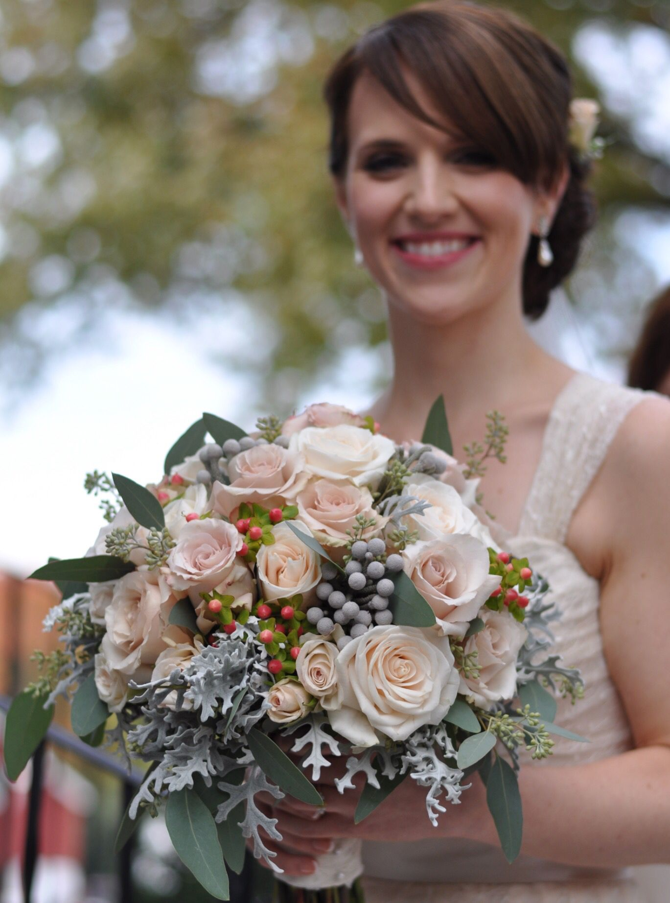 Peach and blush pink roses and stock with gray dusty miller and brunia by Holly's Wedding Flowers.
