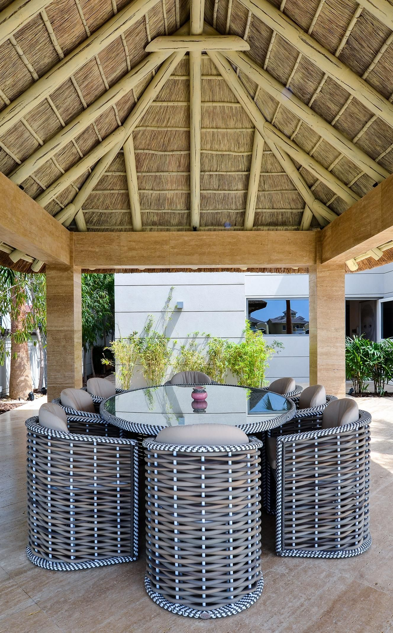 Outdoor Thatched Gazebo With Concrete Pillars And Natural Finish Perfect For Outdoor Dining And Family Time Gazebo Plans Deck Designs Backyard Outside Gazebo