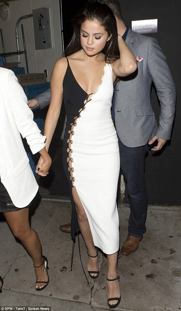 921557406e8 Plunging  Selena Gomez made it a rather glamorous affair as she stepped out  wearing a very.