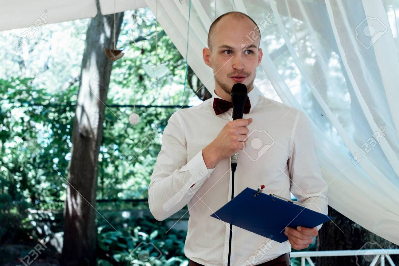 stylish handsome emcee performing speech for toast at wedding reception Stock Photo , #affiliate, #performing, #speech, #emcee, #stylish, #handsome