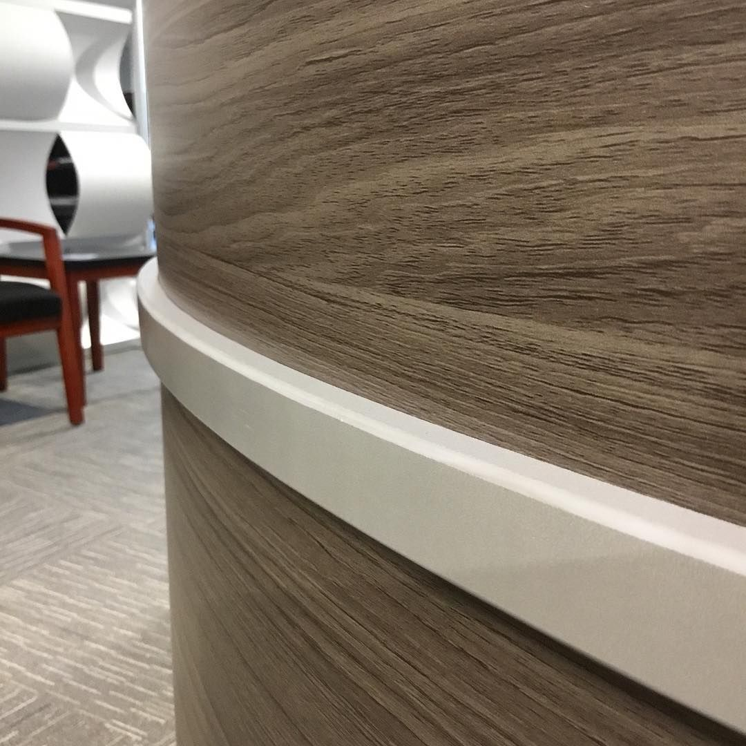 A Driftwood Finish On Curved Reception Desk Gives Off Truly Unique Look