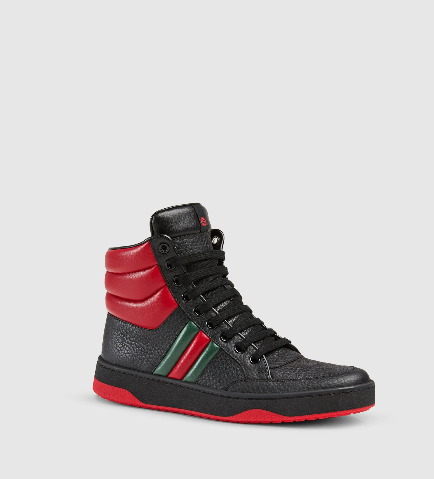 88d32523b59 Gucci Contrast Padded Leather High-Top Sneaker. Black leather with red  padded leather detail. Signature padded leather web detail. Made in Italy.