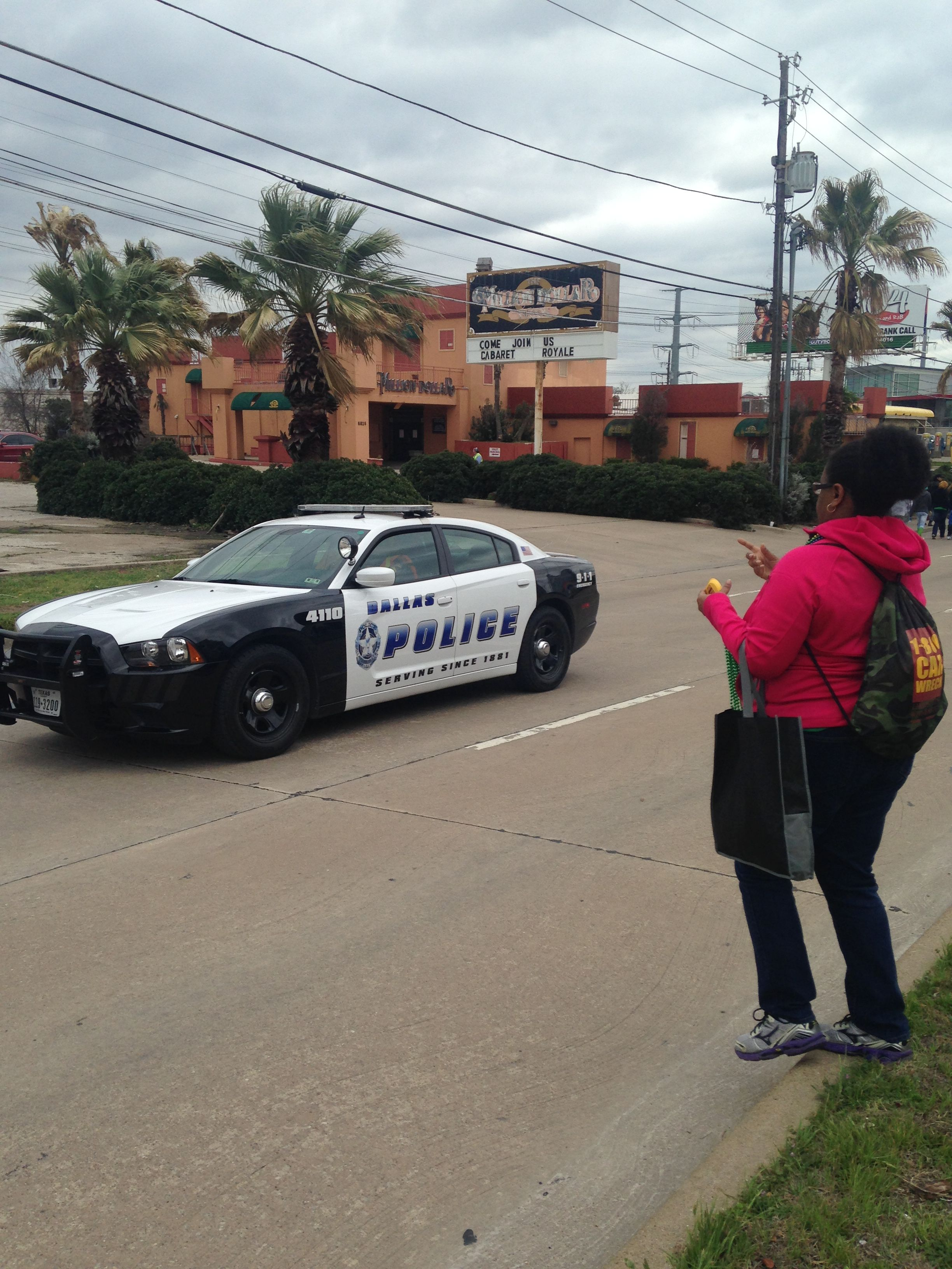 Brandy handing out beads to the Dallas Police #1800StPattysParade