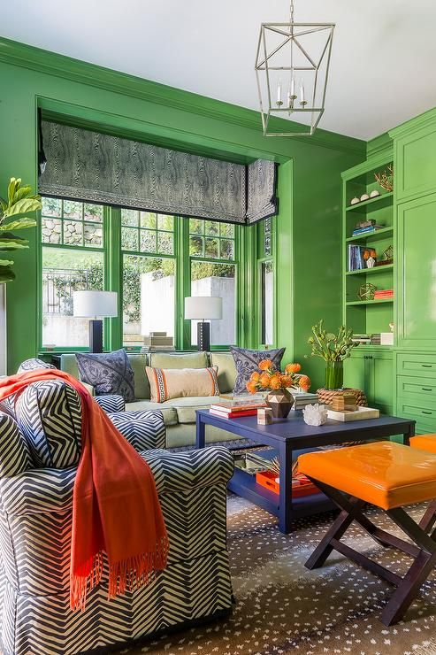 Blue Orange And Green Living Room Features Granny Smith Le Paint On Walls Framing A Window Nook Dressed In Faux Bois Roman Shade Placed Over