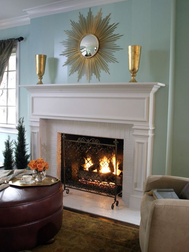 White Brick Fireplace And Blue Green Wall With Decorative Mirror