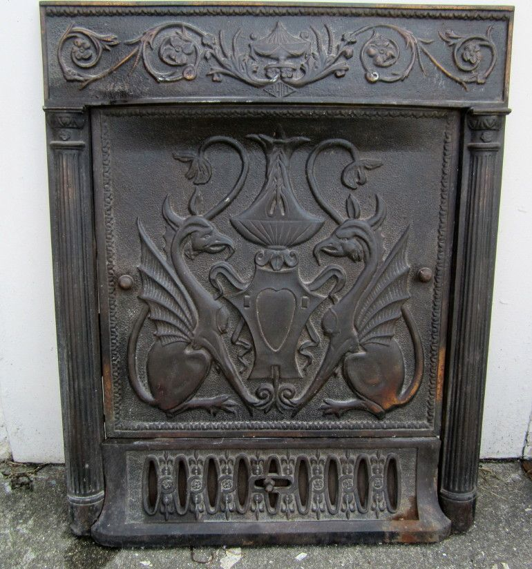 Rare and Magnificent cast iron circa 1900 fireplace surround and summer  cover with stylized griffins. - Rare And Magnificent Cast Iron Circa 1900 Fireplace Surround And