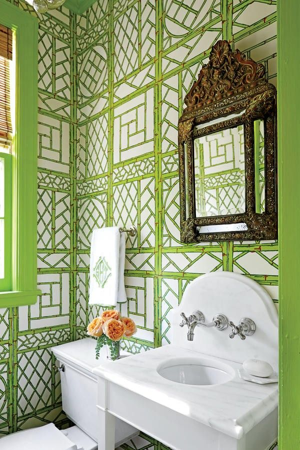 Sarah Bartholomew Powder Room. Tucked off the blue-and-white entry, the powder room is livened up with green lattice wallpaper and matching green trim.