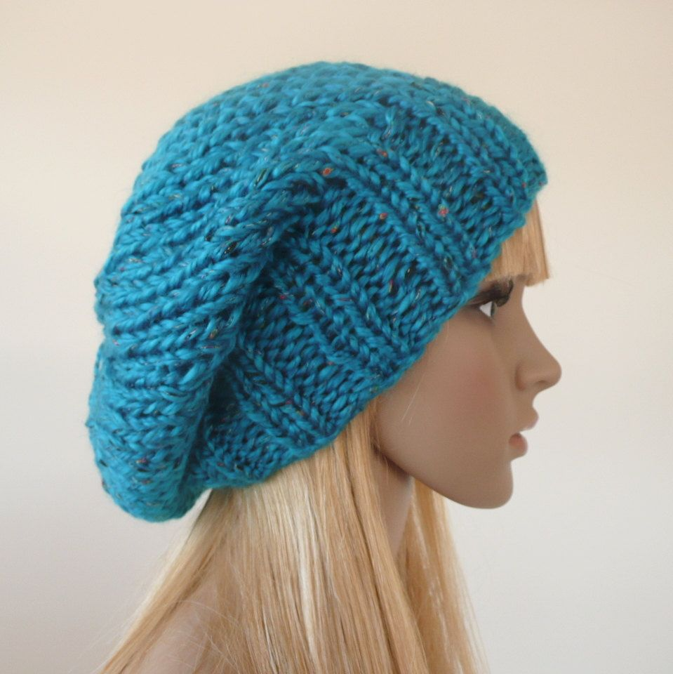 054fd23b1a5 Knitted or crocheted hat in various colors shown in one of the pictures.  Pompoms can be added to each hat for an additional  2.00. 100% Acrylic.