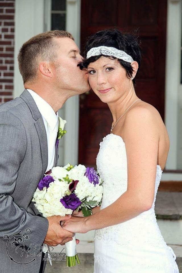 Groom kissing bride Heidi Burks Photography