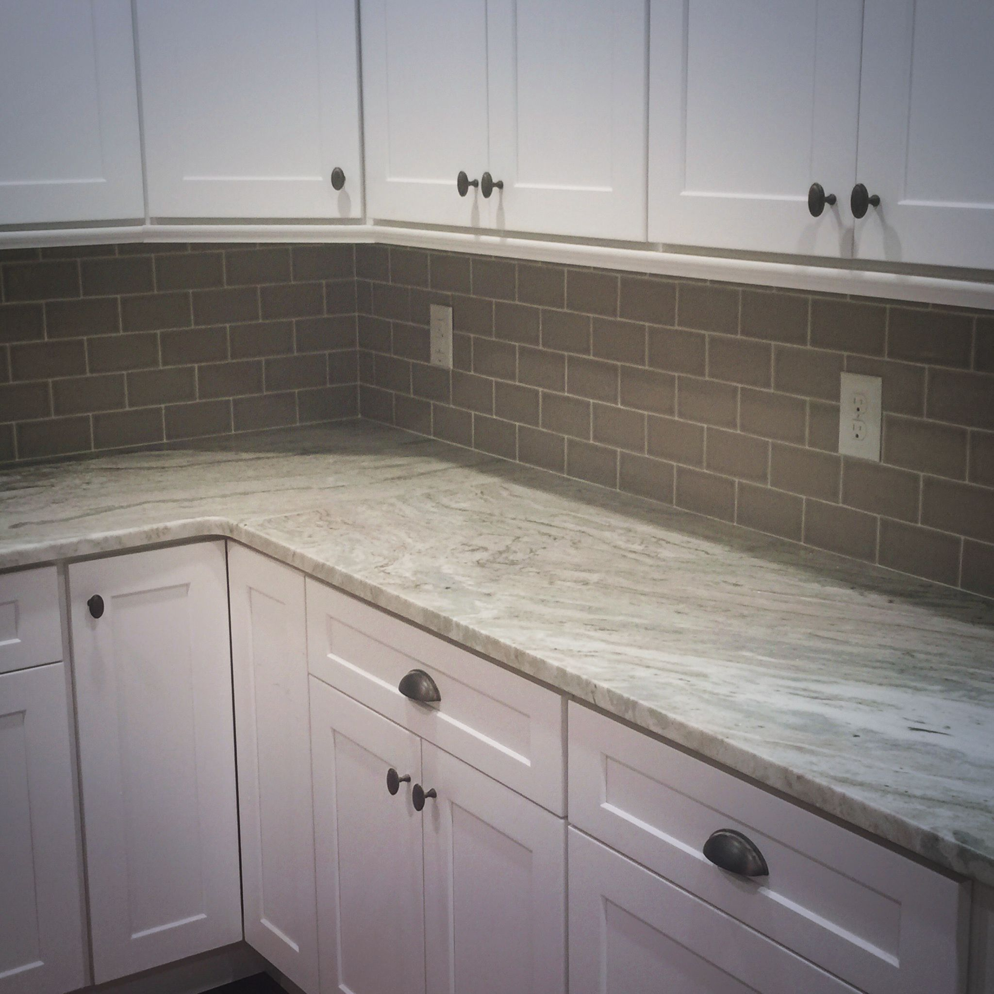 Trendy Gray Subway Tile Used In A Wrap Around Kitchen Back Splash By Old South Flooring Savannah Ga