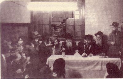 really great photo:  The Rebbe z'l at his first farbrengen as Rebbe on yud Shevat 1951.  Reb Shlomo Carlebach z'l is sitting on his right with the tilted hat