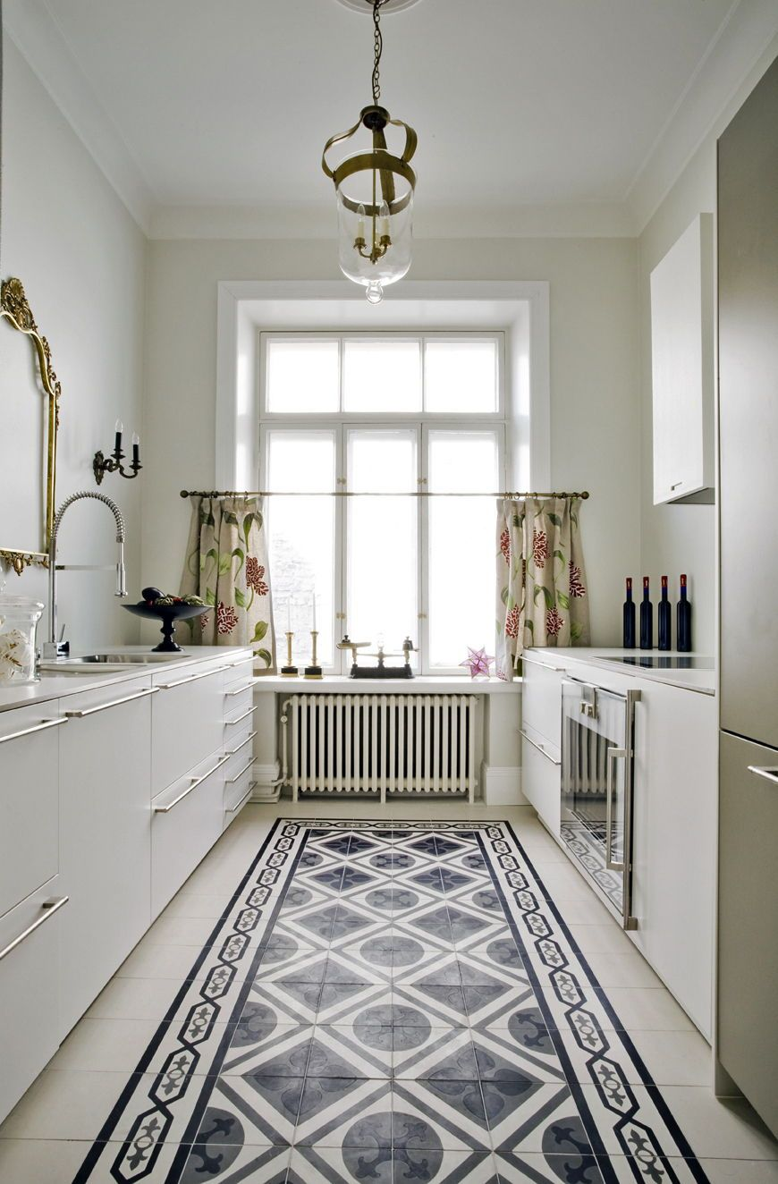 White kitchen with blue, white and grey patterned cement