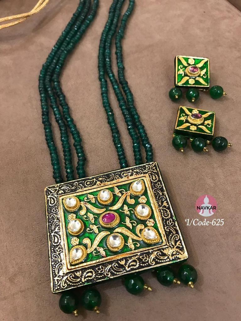 Beautiful green kundan pendant set with meenakari work choker