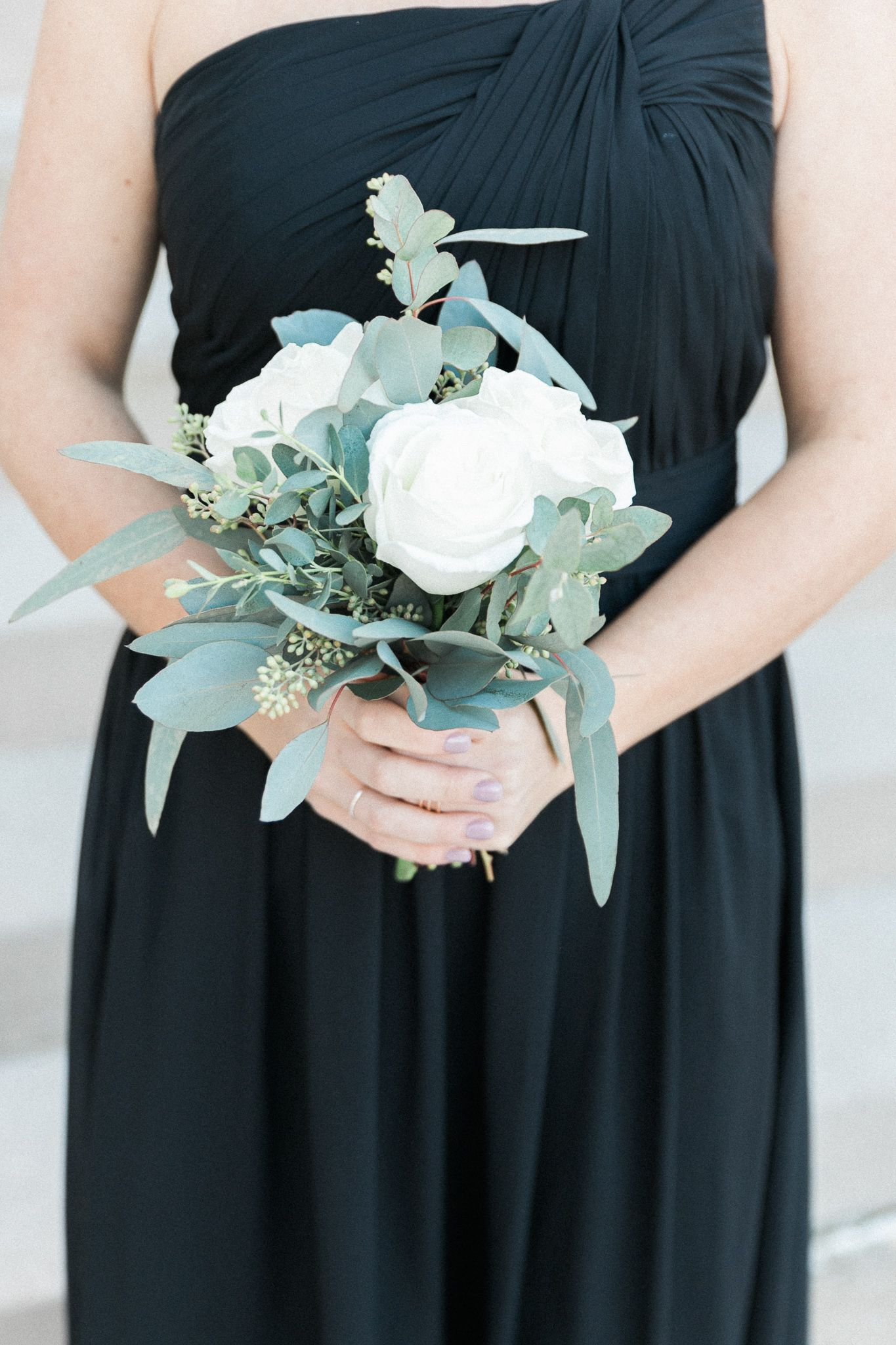 White roses and eucalyptus bridesmaid bouquet. (Photo by Sarah Wesche of Wesche Photography) #bridesmaidbouquets
