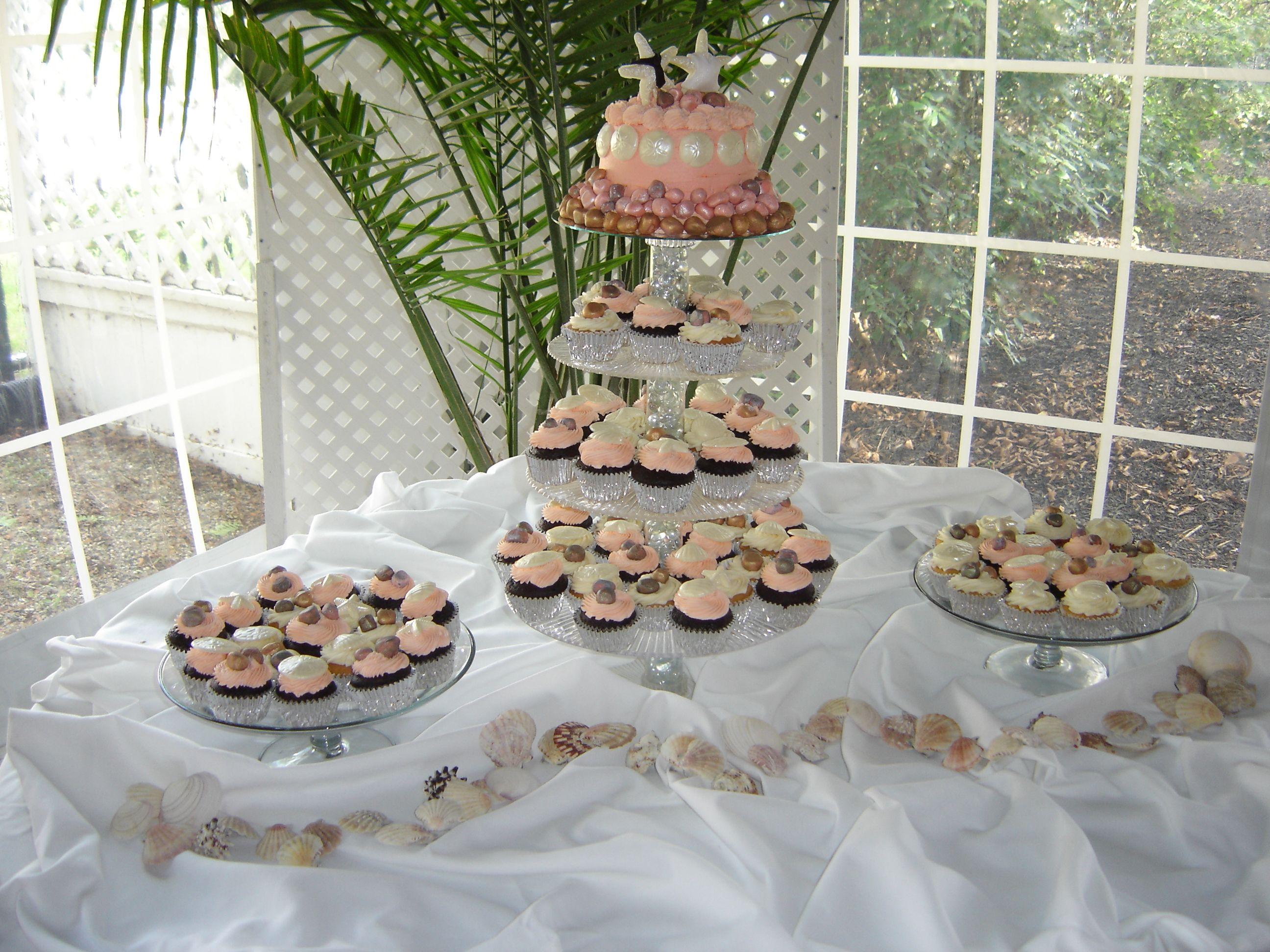 Beach scene cupcake display with bride u groom starfish