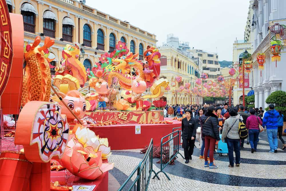 The Senado Square in the historic centre of Macau decorated for the Chinese New Year for the Spring Festival. | The Ultimate Guide to Macau| Macau travel tips | Macau Travel guide | Macau travel | Macau Guide | Macau fun things to do | Macau Bucket List | Macau | Macau Travel Guide Things to Do | Macau Things to Do in | Macau Weekend Guide | Tourist Attractions Macau | Macau Attractions #Macau #Macautravel #Macautravelguide #Macauthingstodo #exploreMacau #visitMacau