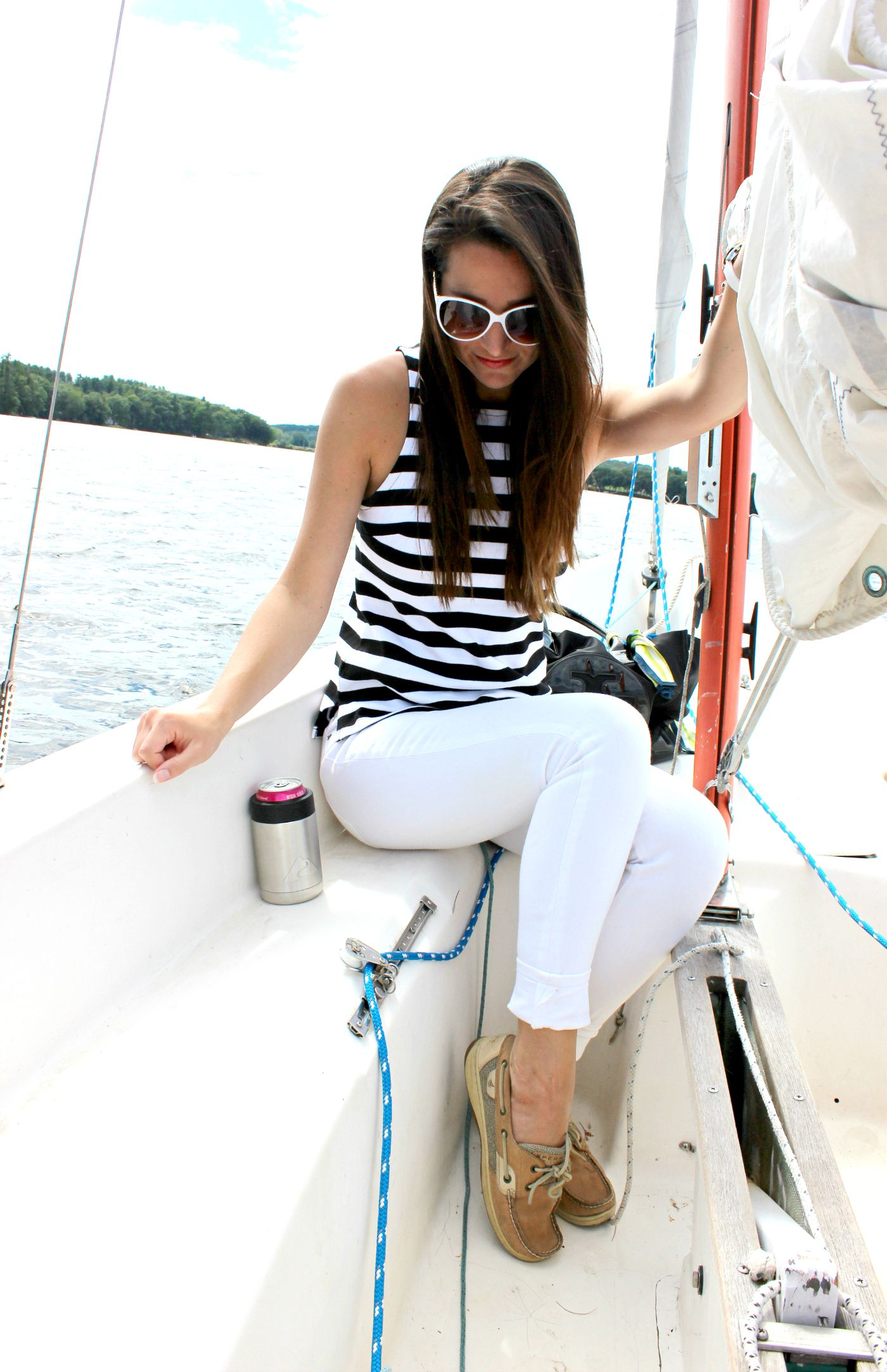 c79f4889411 Banana Republic rugby stripe tank top with white skinny jeans and classic  Sperry boat shoes. Such a perfect Labor Day outfit idea for women!