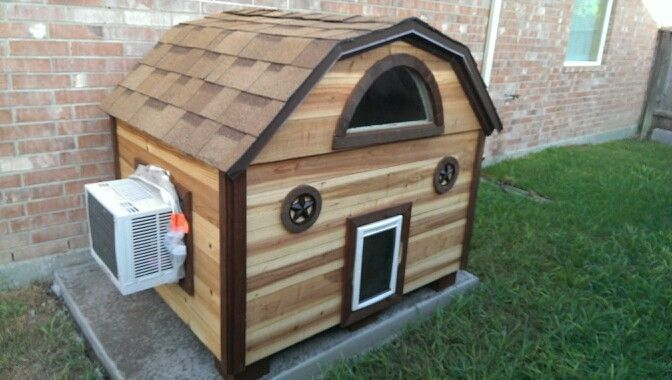 Our new AC dog house made of cedar insulated with shingles & window Look on craigslist