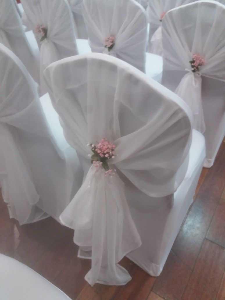 A White Voile Hood Over A White Stretch Chair Cover With Mini