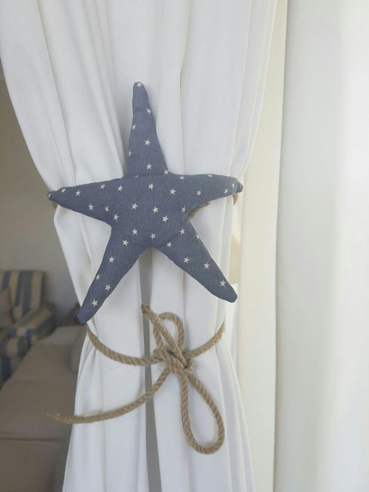 Recogedor  cortina estrella