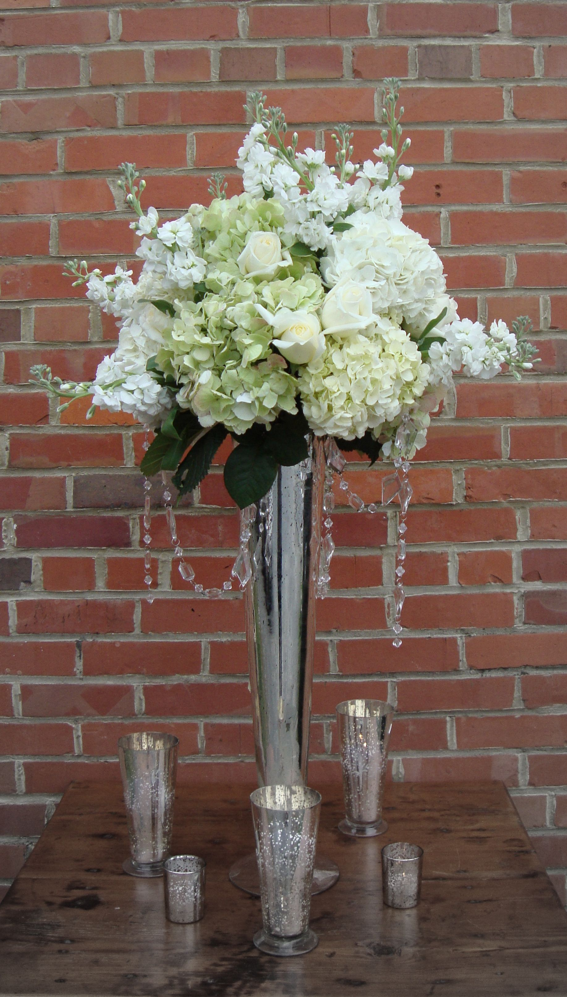Tall arrangement white hydrangea stock roses antique