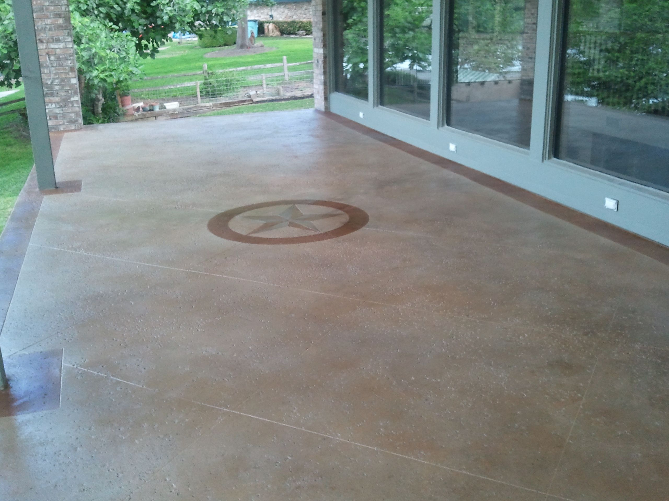 Concrete stained salt finished patio with maylay tan stain for Black stains on concrete