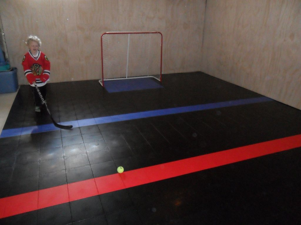Basement hockey rink with a sport court floor for the for Basement sport court