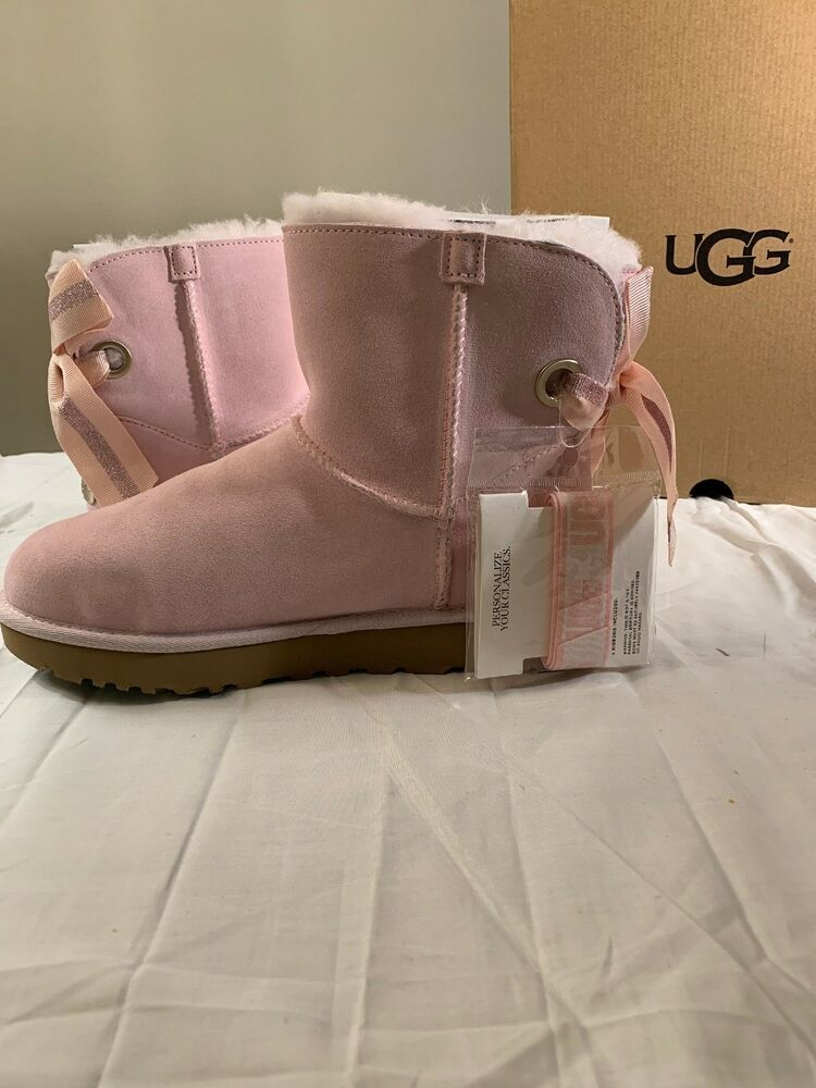 0467918192f UGG CUSTOMIZABLE SHORT BAILEY BOW RIBBON SEASHELL PINK SUEDE BOOTS ...