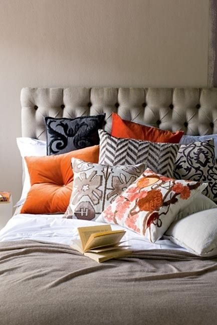 Love the mix of navy taupe and orange patterns ... Too many pillows in total but I like the sentiment